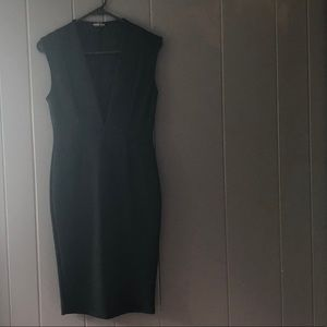 Dresses & Skirts - Black sleeveless dress with plunging neckline
